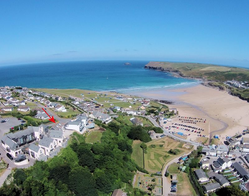 An aerial view of Pinewood Flat 4, a self-catering holiday apartment in Polzeath, Cornwall, showing its position near the beach.