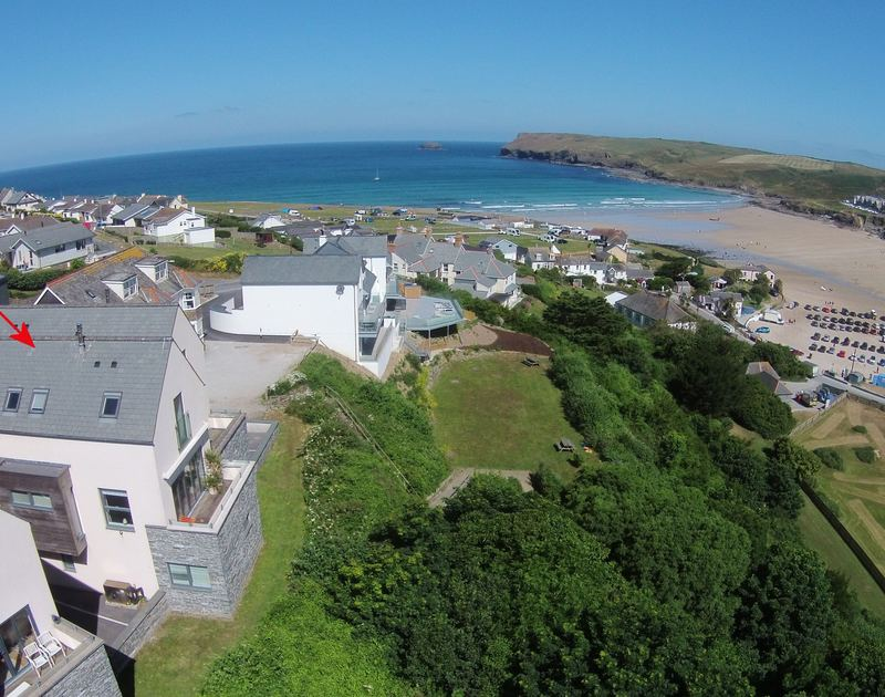 An aerial shot of the elevated location of Kellan, a holiday house at Polzeath, Cornwall, with the beach just down the hill.