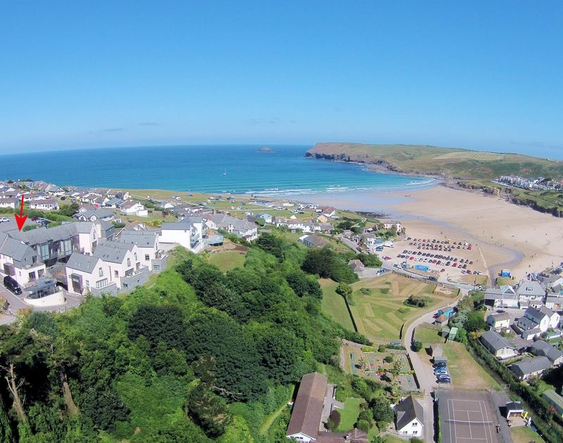 An aerial view of The Beach Hut, a dog friendly, self catering holiday house by the sea and beach at Polzeath in North Cornwall.