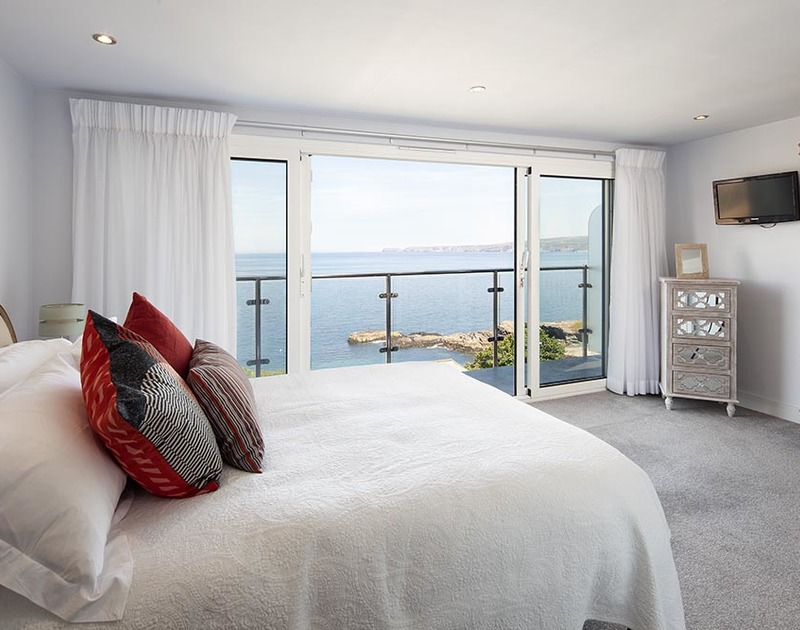 The top floor bedroom at The Crows Nest has a private balcony with panoramic sea views of Port Isaac bay.