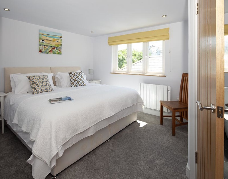 The top floor rear bedroom at The Crows Nest in Port Isaac is light and sunny with an ensuite shower room.