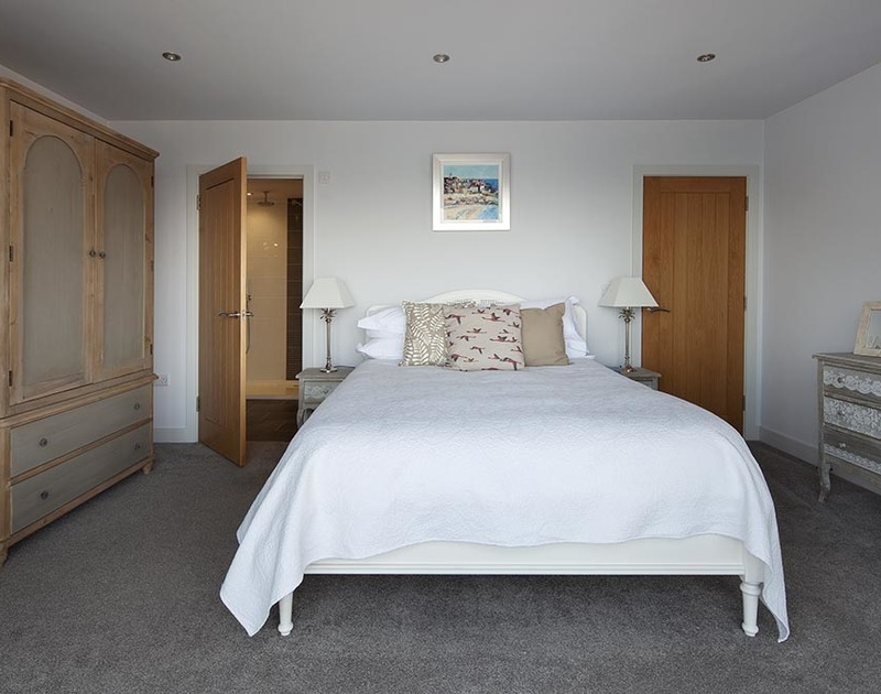 The master suite on the first floor at The Crows Nest in Port Isaac has a large walk-in ensuite shower