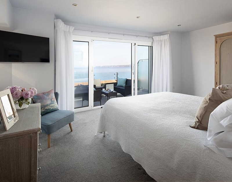 Enjoy stunning sea views from the beautiful master bedroom at The Crows Nest in Port Isaac from its full length balcony