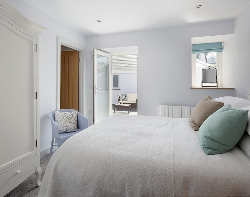 The rear ensuite bedroom on the first floor at The Crows Nest in Port Isaac has its own private sun terrace