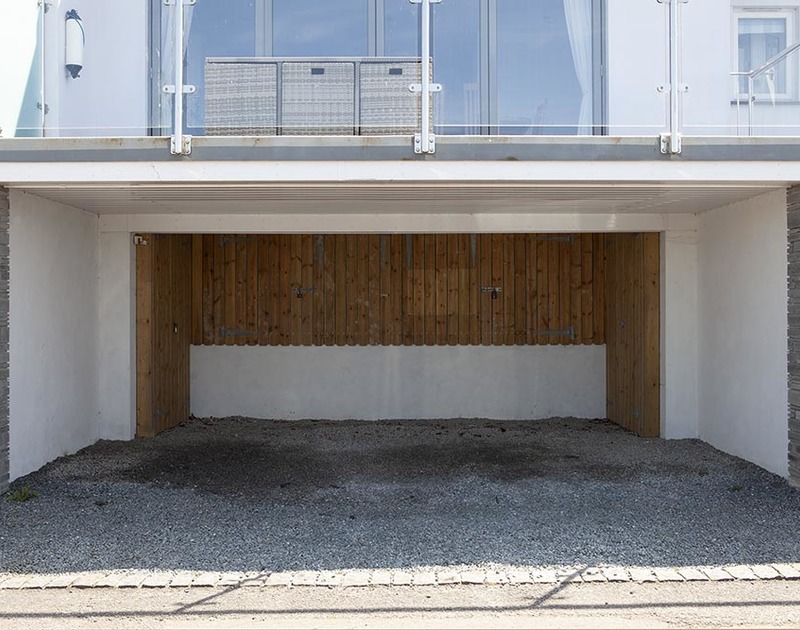 A carport with storage is located directly underneath The Crows Nest in Port Isaac, North Cornwall