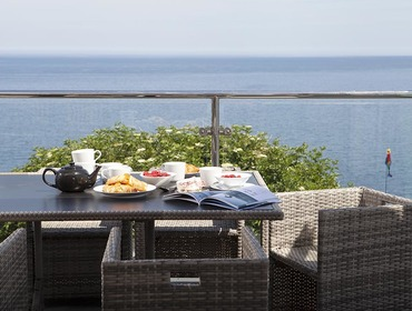 The balcony at The Crows Nest in Port Isaac overlooks the sea and is perfect for enjoying long lazy breakfasts.