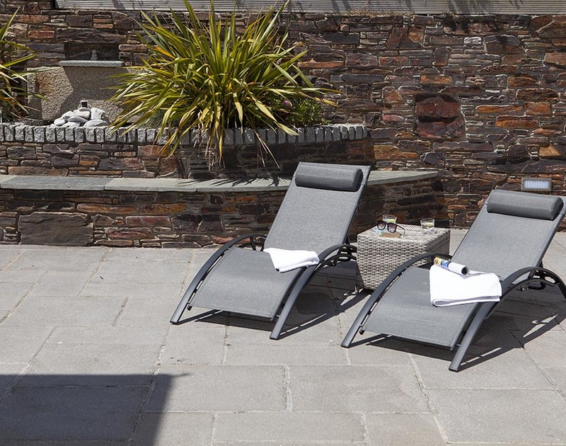 A sunny rear terrace at The Crows Nest in Port Isaac, Cornwall is the ideal spot to sunbathe and laze away the afternoon