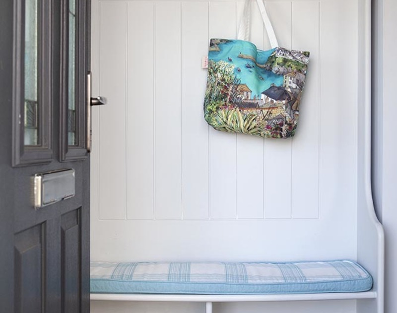 Hang up all your coats and bags on the cheery settle in the entrance hall at The Crows Nest.
