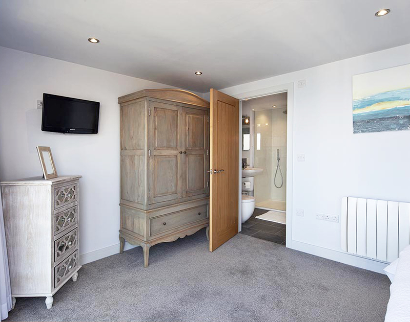 The spacious bedroom on the top floor at The Crows Nest in Port Isaac has an ensuite shower room