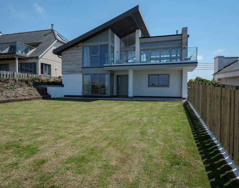 The striking, modern exterior of Point Break, a luxurious holiday house in Polzeath taken from the end of the garden.