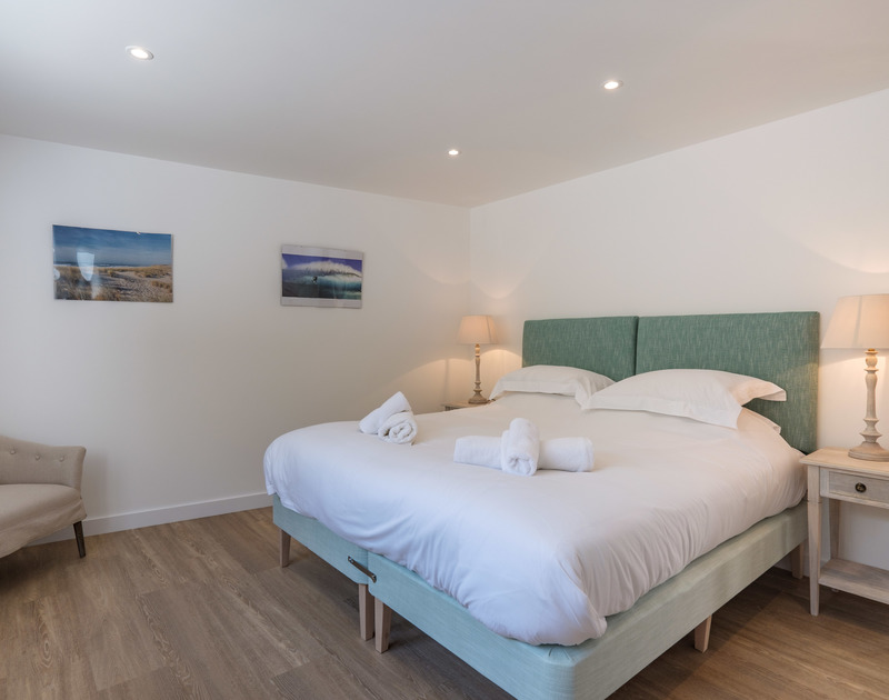 Practical options in one of the ground floor bedrooms at Point Break with zip and link beds.