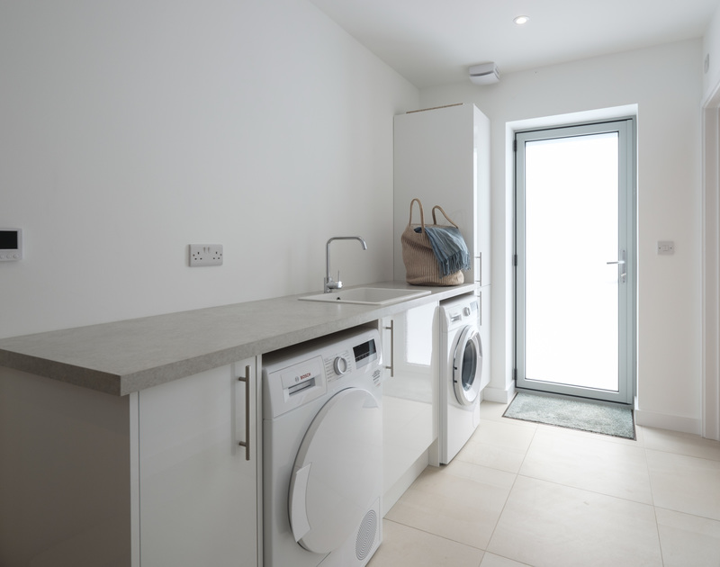 The useful utility room with external door at self catering holiday house Point Break in Polzeath.