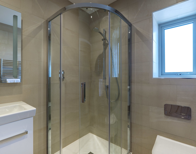 The stylish shower room off the utility room at luxury holiday house Point Break in Polzeath.
