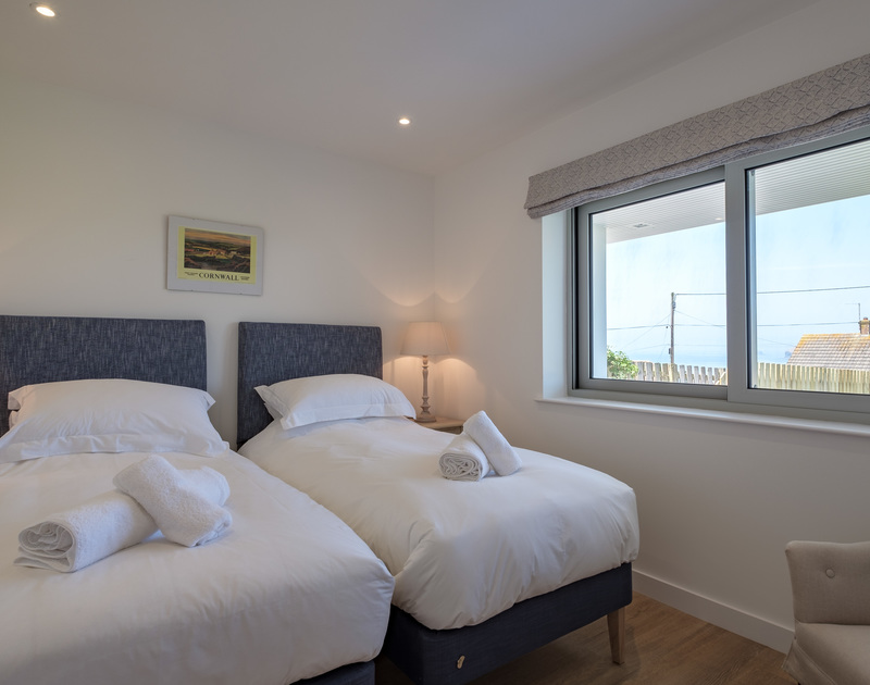 The twin bedroom with views of Polzeath at self catering, holiday house Point Break.