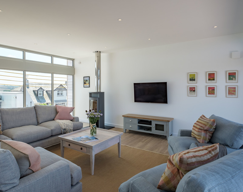 Relax on the squashy sofas and light up the efficient new wood burning stove in the sitting room at Point Break, a self catering, holiday house with Polzeath Beach almost on the doorstep.