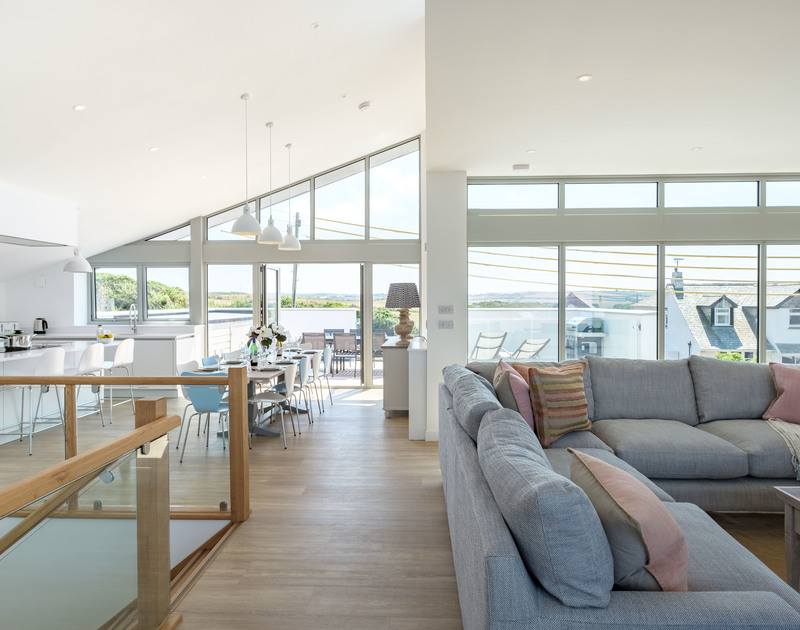 Beautifully designed open plan living space on the first floor at Point Break in Polzeath, Cornwall.