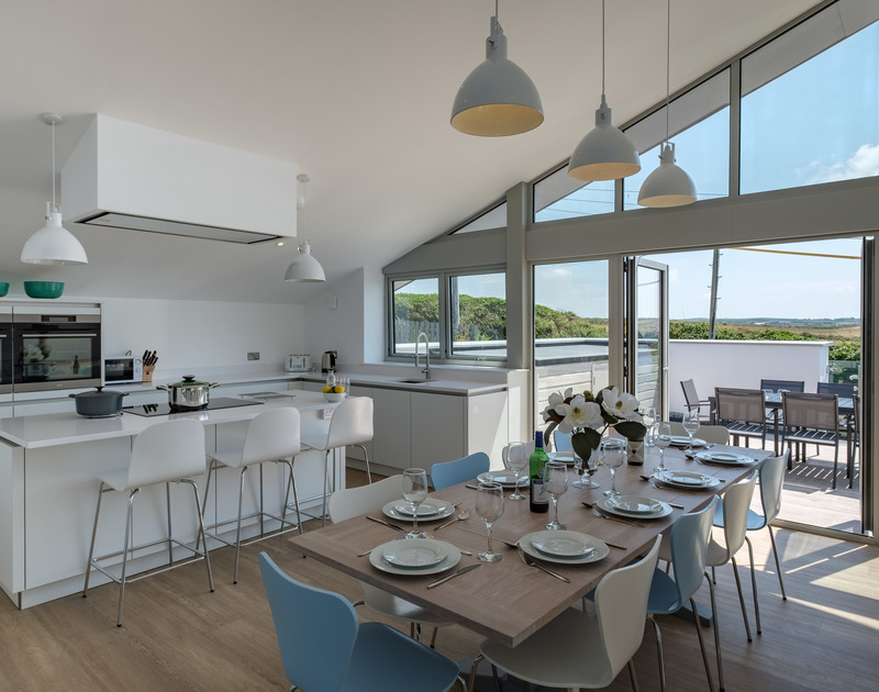 Point Break's state of the art kitchen has an adjacent dining area and a separate terrace for eating outdoors with far reaching countryside views