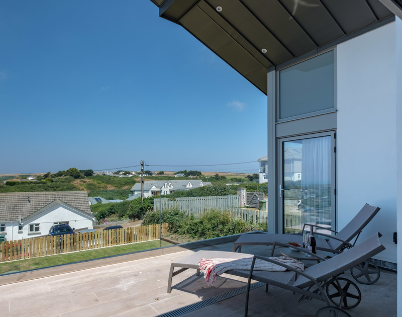 Relax and enjoy the birds eye views from the decked balcony off the master bedroom at Point Break in Polzeath.