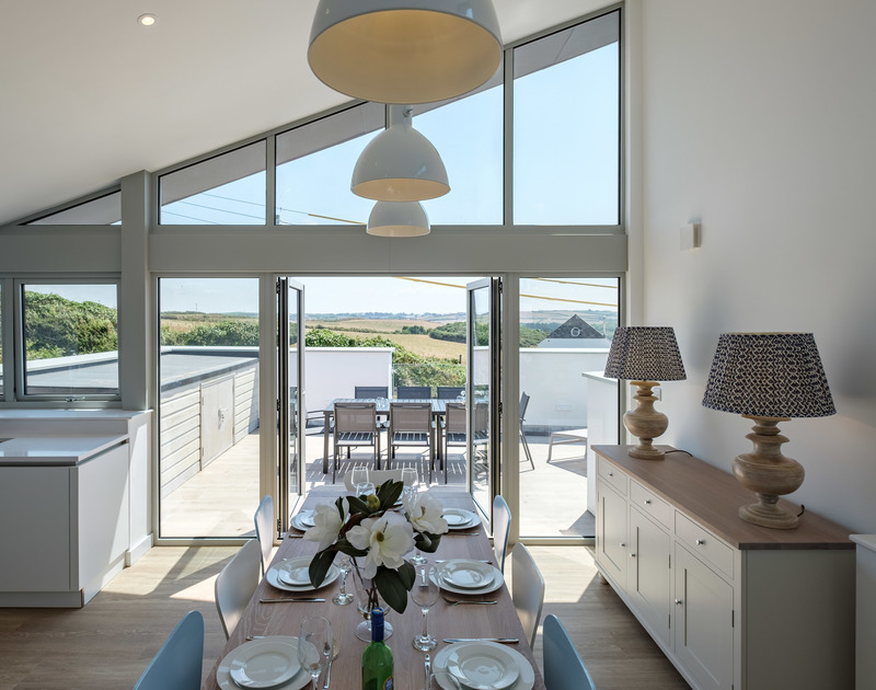 Make the most of sunny mornings and glorious sunsets to dine outside on the terrace at Point Break in Polzeath, Cornwall