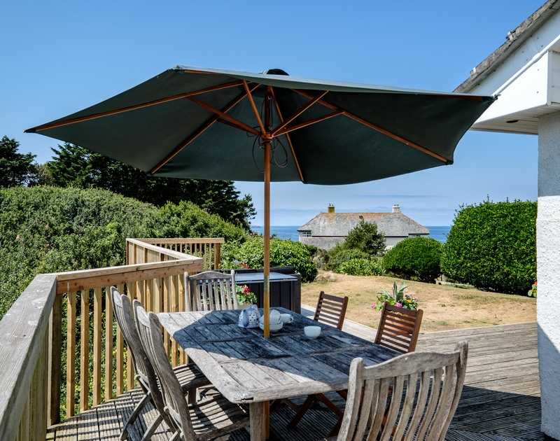 Family meals outside on the decking at self catering, holiday house Quarry Cottage in Polzeath.