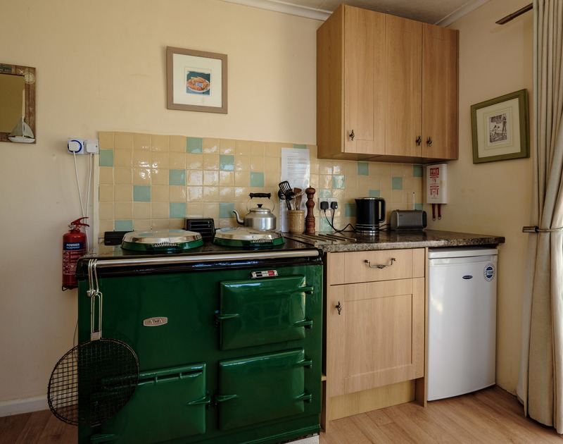Make use of the fabulous bottle green AGA in the kitchen at Quarry Cottage,