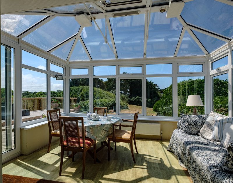 Spacious conservatory for relaxation and warmth at self catering, holiday property Quarry Cottage in Polzeath.