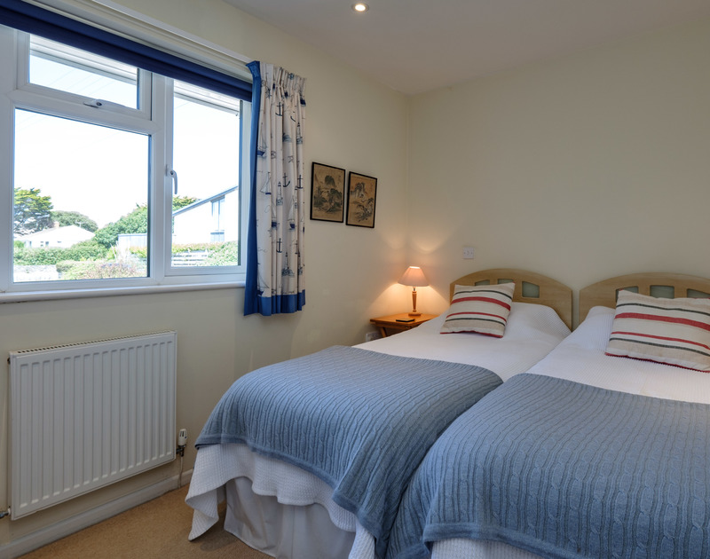 One of the twin bedrooms at Quarry Cottage with an ensuite shower.