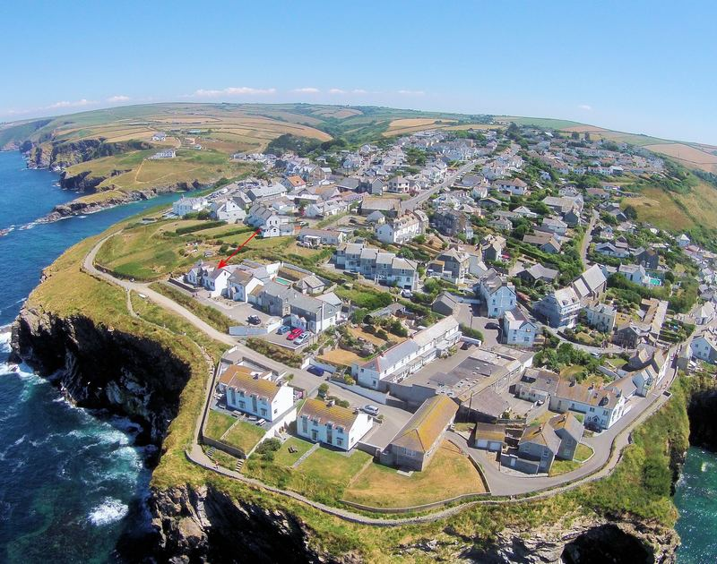 An aerial view showing the exact location of fabulous cliff top holiday accommodation Cliffside 1 in Port Isaac in North Cornwall.