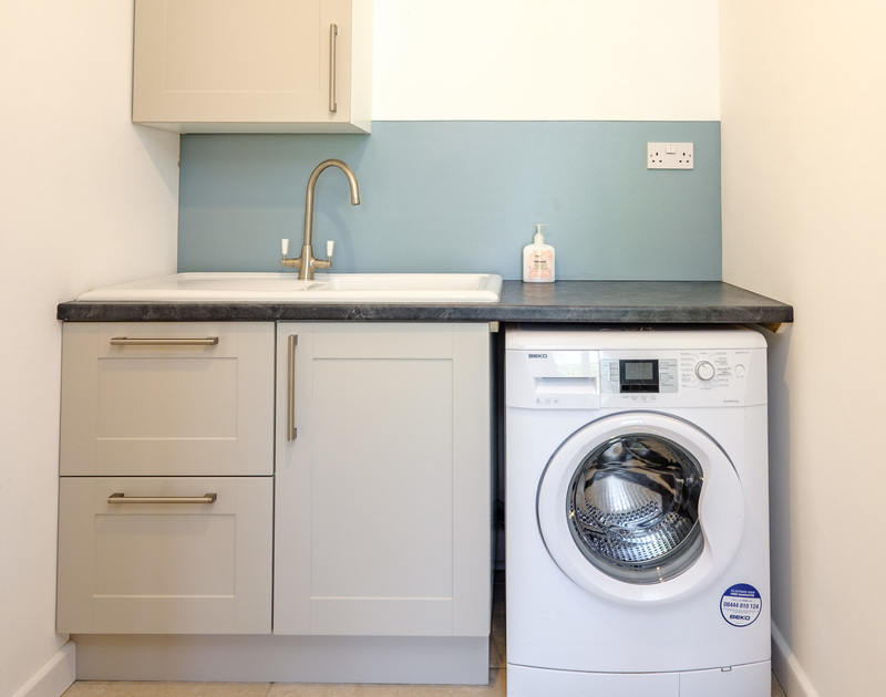 The utility room at Chimings self catering pet-friendly holiday home in Rock, North Cornwall.