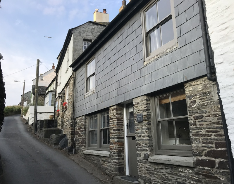 The pretty stone and part slate hung exterior of Scuppers nestled a little way up Church Hill from Port Isaac's pretty harbourside.