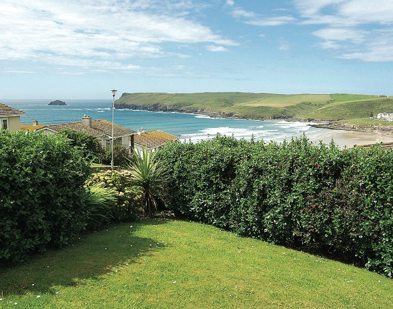 The far reaching sea views from the garden at Atlantis, a self catering holiday house for rent in Polzeath, Cornwall.