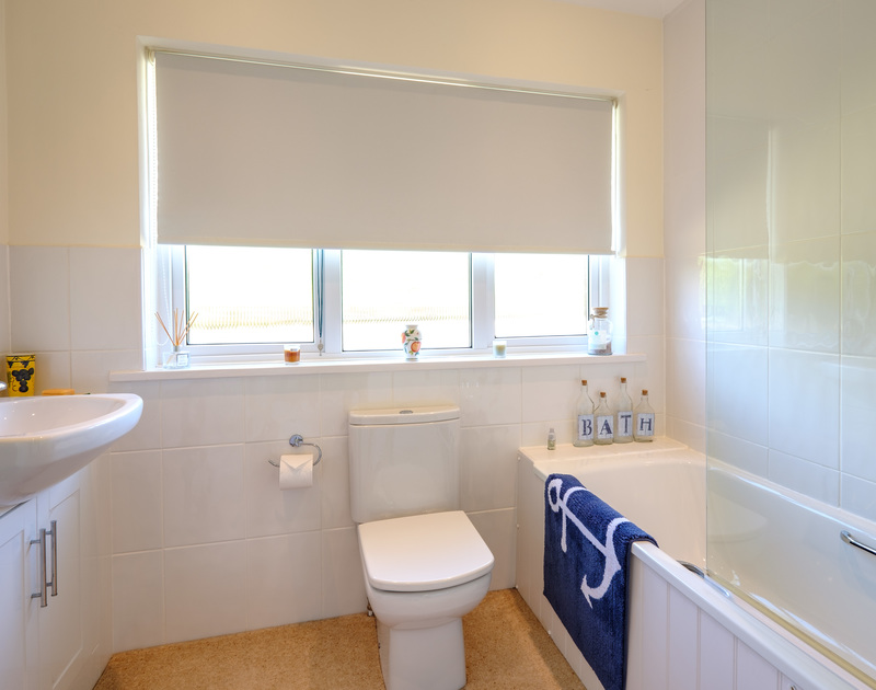 The bright, good sized family bathroom at Atal Mor Chei, in Rock, Cornwall.