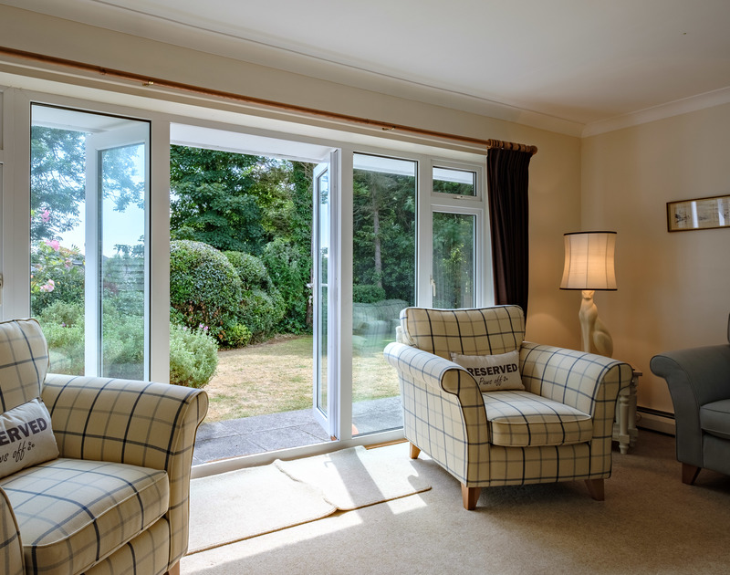 French doors into the garden from the sitting room at self catering Atal Mor Chei in Rock, north Cornwall.