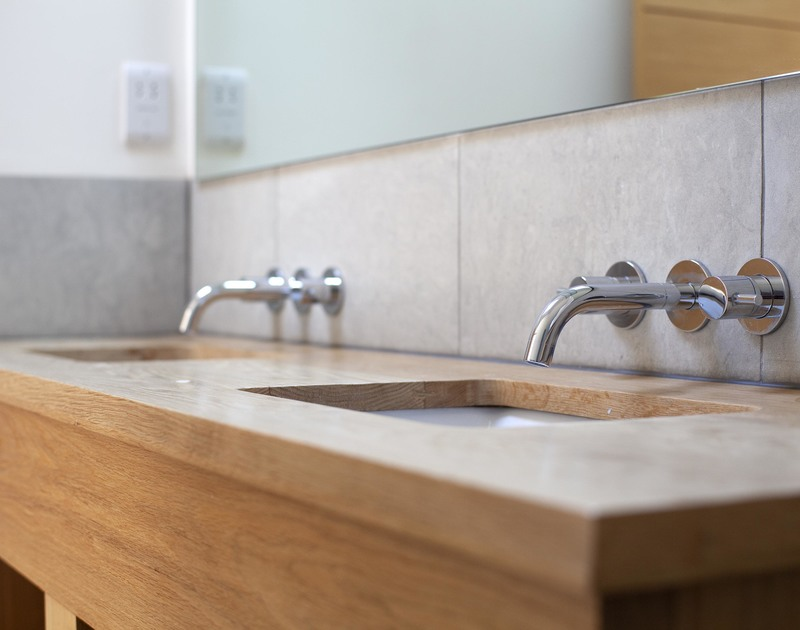 Stylish wooden topped double basins in one of the six bathrooms at Church Lane House close to the beach at Daymer bay in Cornwall.