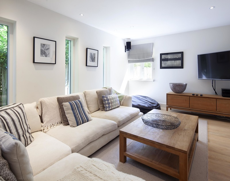 Teens and children can relax in the sophisticated snug room with a smart TV and a SONOS sound bar at self catering, holiday house Church Lane House in Daymer Bay.