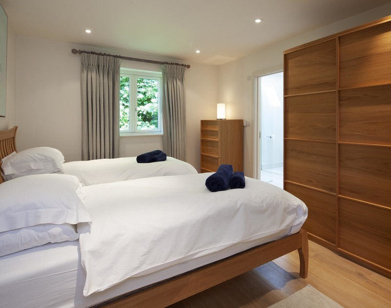 One of the twin bedrooms with an ensuite at luxury, coastal, holiday home Church Lane House in Daymer Bay, North Cornwall.