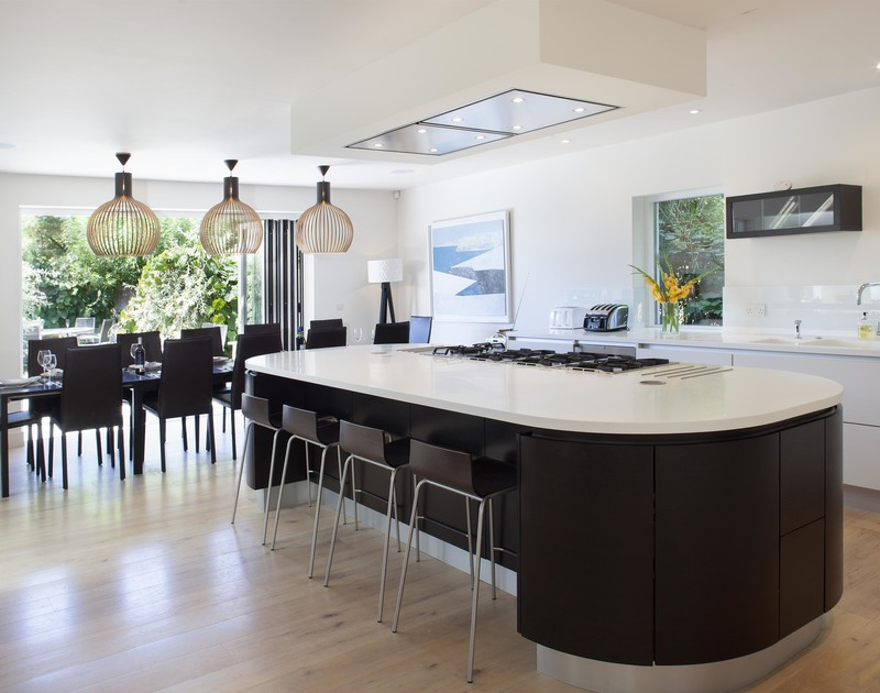 Sophisticated open plan living in the contemporary, open plan kitchen/dining room and reception area at exceptional holiday house Church Lane House in Daymer Lane.