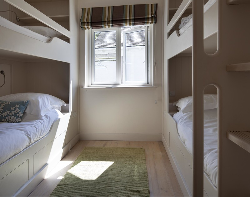 Superbly designed fitted double bunk beds on the ground floor at self catering Church Lane House in Daymer Bay.