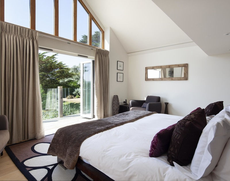 The indulgent Emperor bedroom that has it's own private balcony, dressing room, ensuite shower room and steps up to a mezzanine bath spa area.