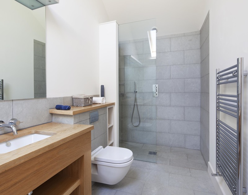 A modern shower room, one of six bathrooms at luxury holiday property Church Lane House in Daymer Bay on the North Cornish Coast.