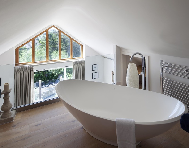 Luxuriate in the fabulous feature bath on the mezzanine ensuite bathroom from the Emperor Bedroom at self catering Church Lane House.