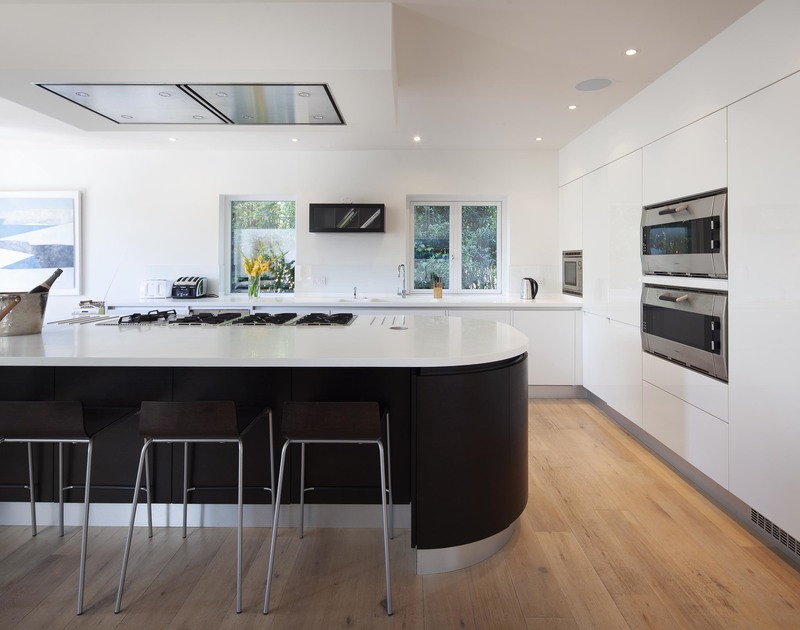 Large, modern breakfast bar in the sleek kitchen at self catering, holiday property Church lane House a short walk from the beach at Daymer Bay.