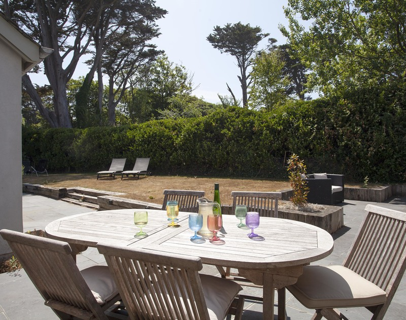 Enjoy drinks in the garden on the terrace at Church Lane House after busy days on the beach at nearby Daymer Bay.