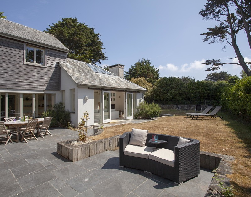 There's room for everyone at self catering Church lane House, with lawn and a large slate paved terrace.