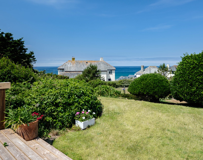 Views down the garden and out to sea at self catering, holiday property Quarry Cottage.