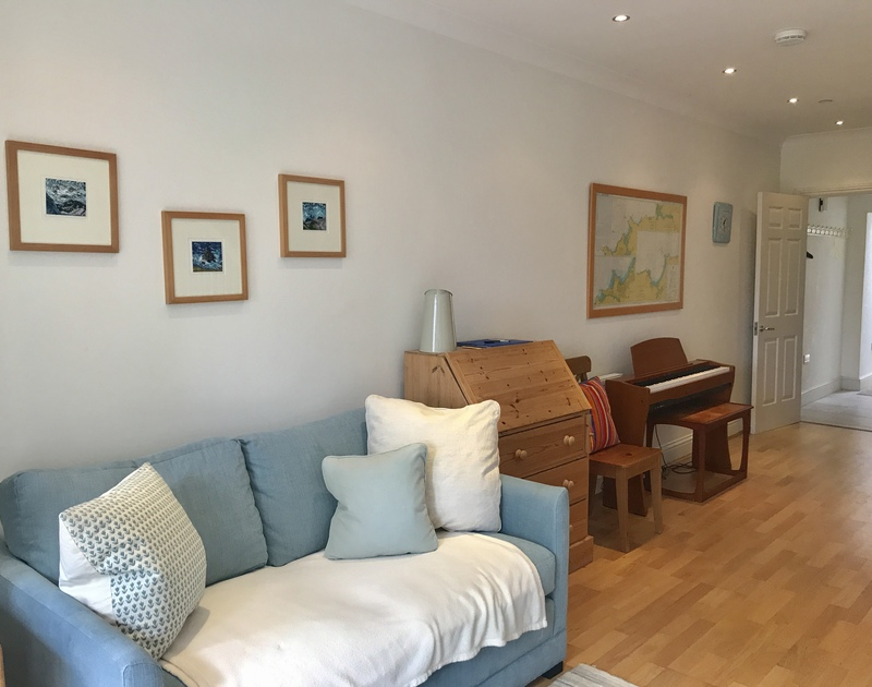 Open plan sitting room, dining room and kitchen at self catering holiday rental Lowenna Manor 9, in Rock, Cornwall.