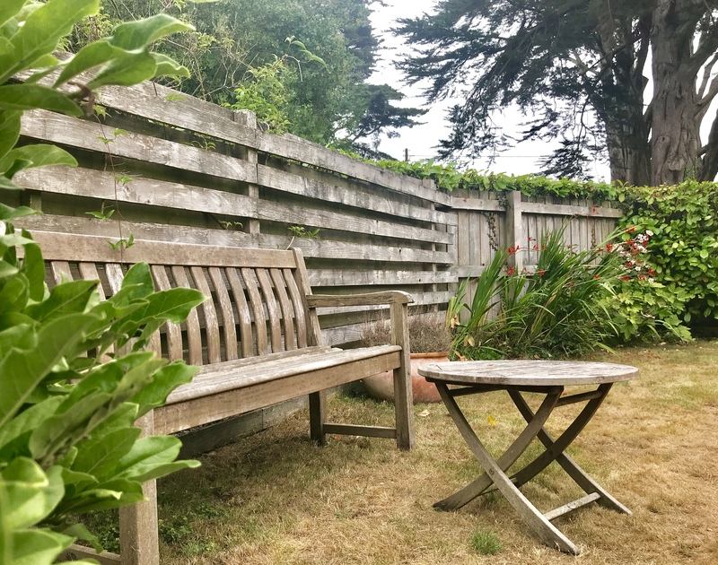 Enjoy a sit down and a bit of peace in the enclosed garden at Lowenna Manor 9, a self catering holiday house in Rock, Cornwall.,