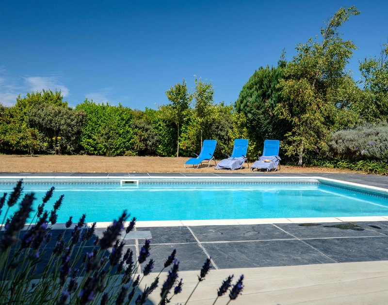 The heated swimming pool at Trerokken available from late May to September