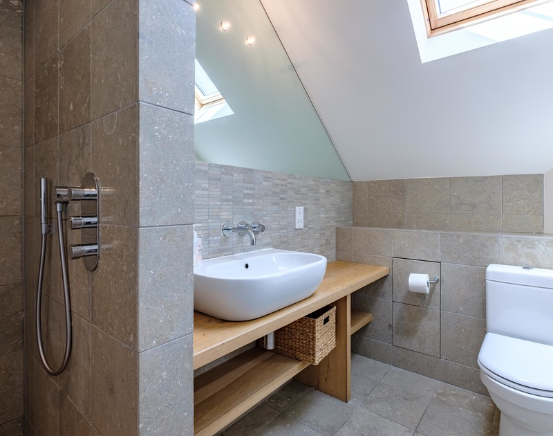 The Master bedroom at Trerokken in Rock, Cornwall has a serene ensuite wet room.