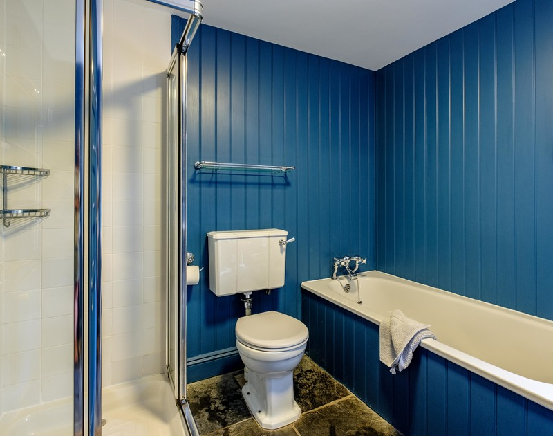 The funky blu family bathroom on the ground floor at Old Brea Coach House in Daymer Bay